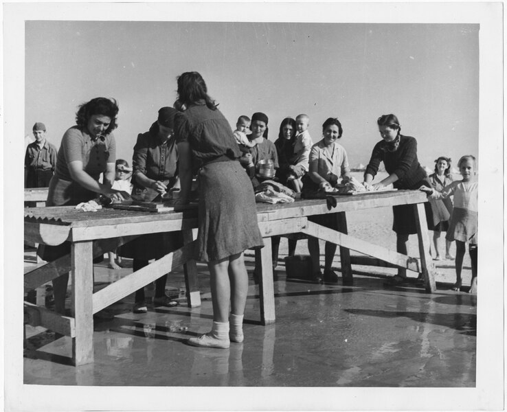 A photograph from 1945 from the El Shatt camp in Egypt shows women washing their clothes outside.