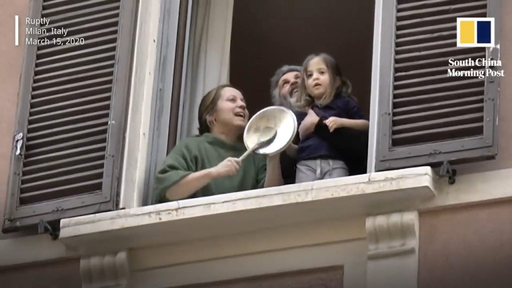 Italians making music from their balcony