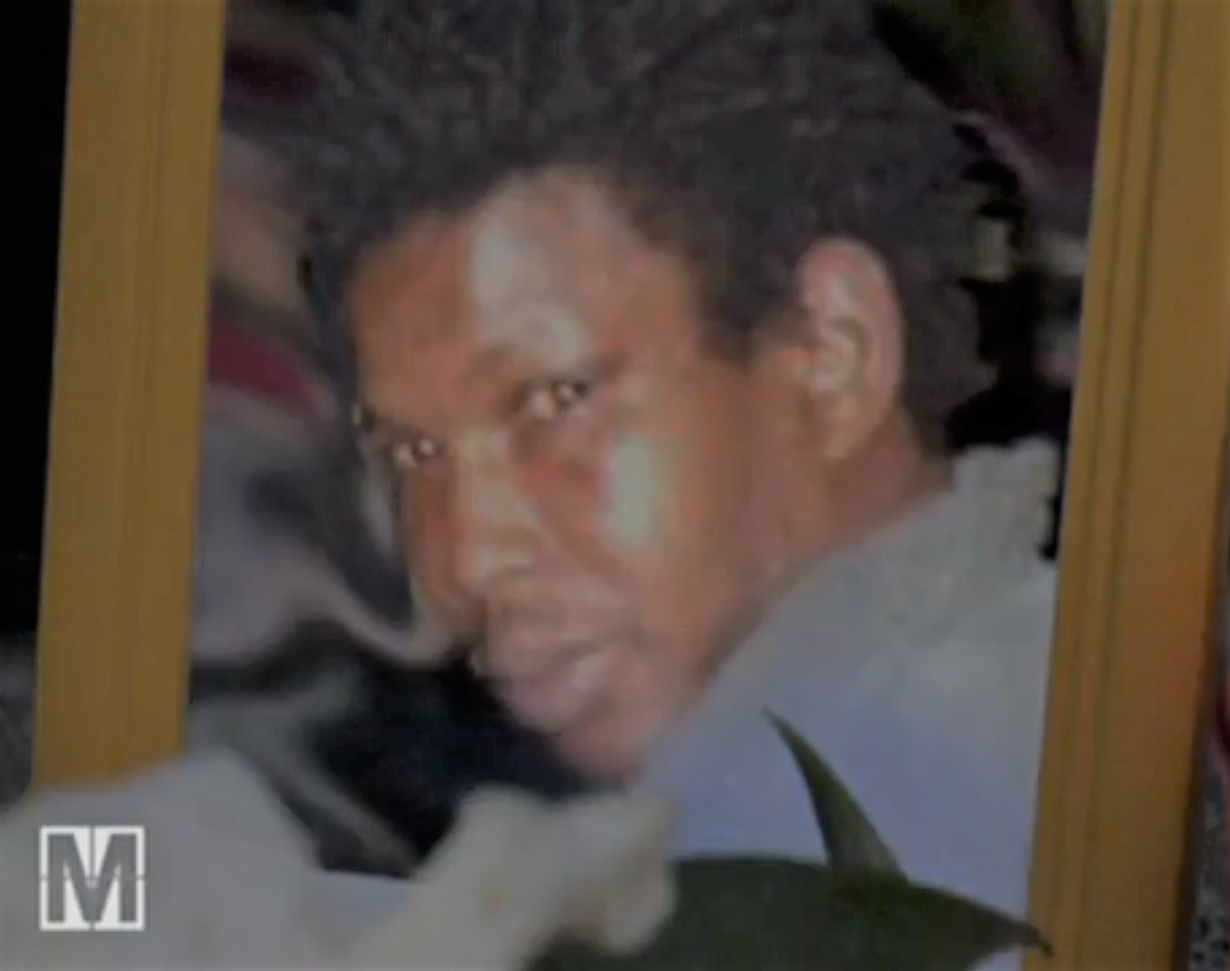 Picture of Oury Jalloh, victim of black police brutality alongside George Floyd
